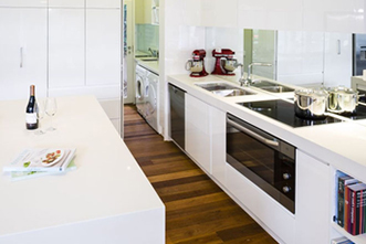 Modern kitchen renovation with stone benchtop by Sydney Budget Kitchens