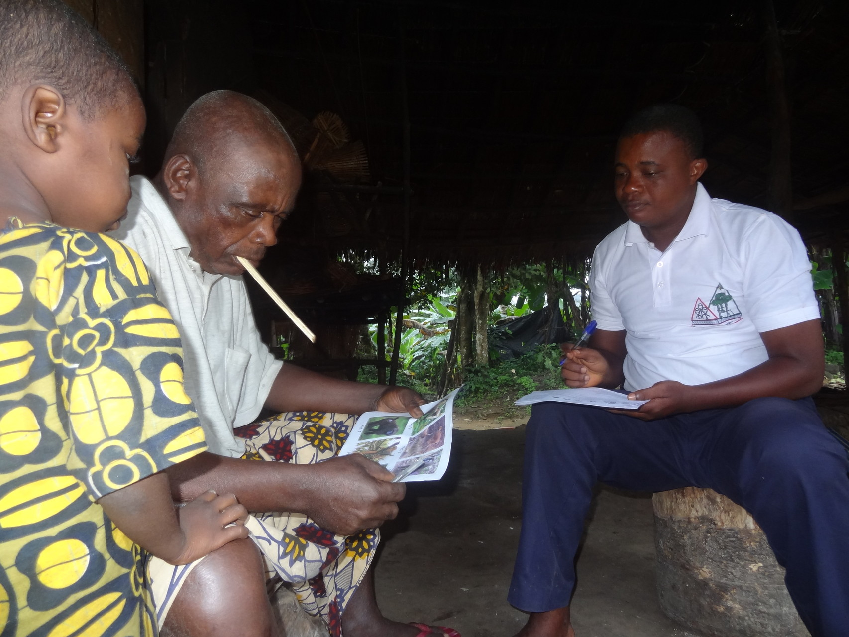 Administering questionnaires at village sensitation meeting