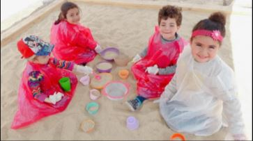 We are so happy to play with sand!