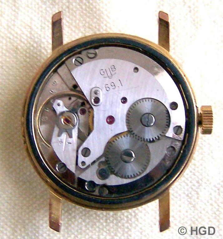 GUB Kal.69.1 offenenes 34 mm Gehäuse - Werk passt und ist mit Metalllaschen zum Gehäuse hin gesichert