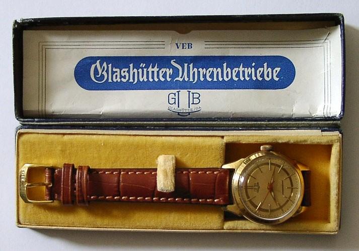 GUB Herrenarmbanduhr Kaliber 60.1 mit originalbelassenen Werk, Gehäuse, Zifferblatt & Zeigersatz in der Originalverpackung