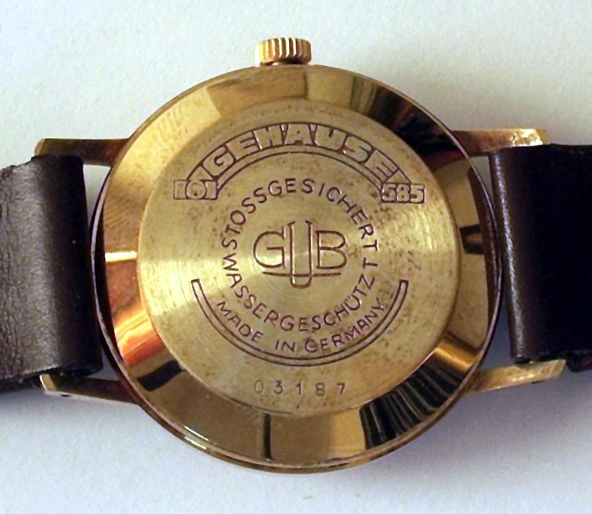 Original belassene GUB Kal. 75 mit massiven gedrücktem Golddeckel