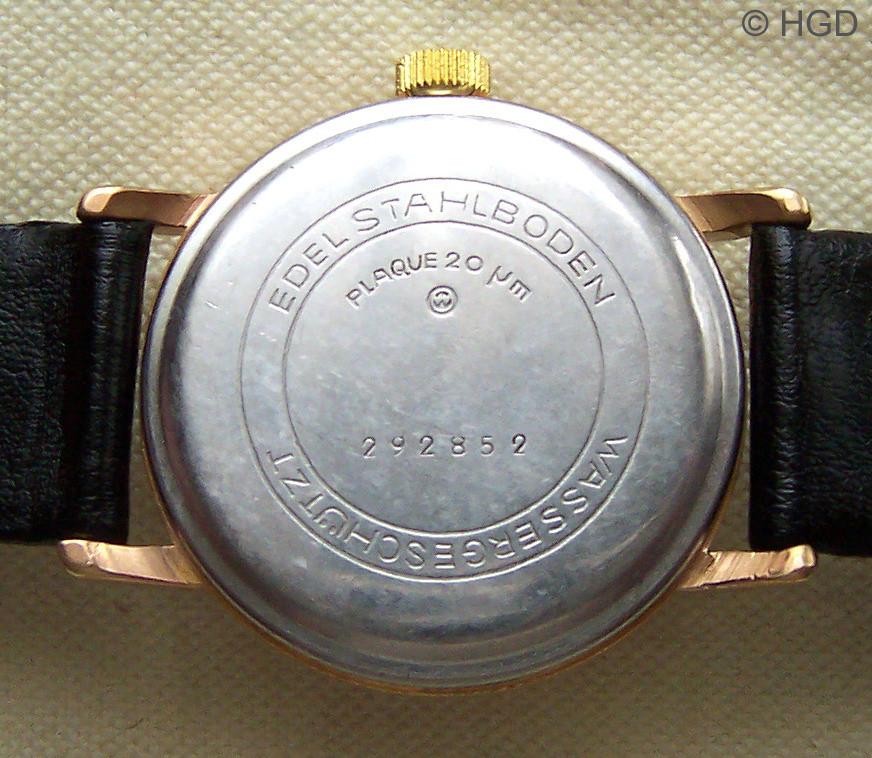 Edelstahldruckdeckel eines 20 Micron Plaque Gehäuses des Feingerätewerkes Weimar für die Kalibergruppe 70 mit Firmensignet