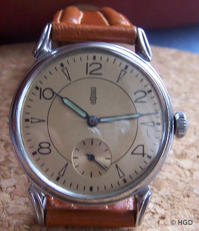 GUB Uhr mit Kaliber 613 und decoriertem Werk