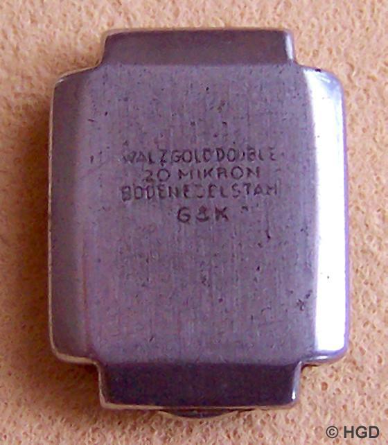 Edelstahldruckdeckel mit Gehäusemarke der Firma Gebüder Kuttroff Pforzheim .