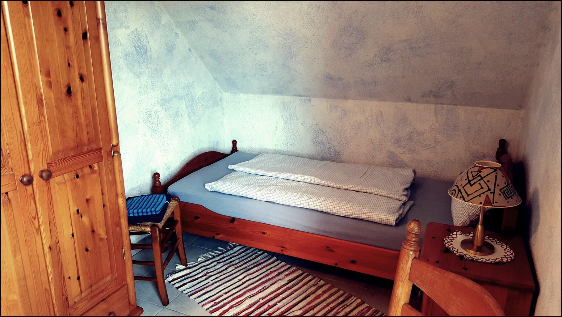 Unser 2. Schlafzimmer mit 1x Doppelbett + 1x Einzelbett