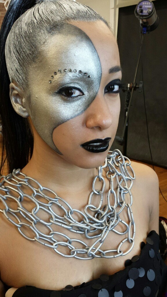 Face is finished, hair is painted, and chains are on. Those chains were cold. Brrr!