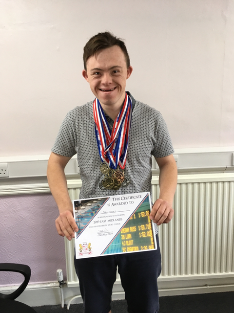 Jake with his medals and certificate