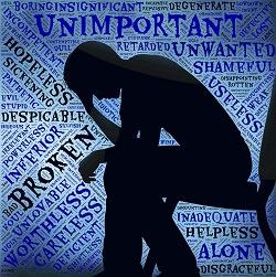 Mann sitzt inmitten von Begriffen zur Depression