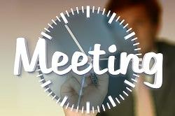 Uhr mit Begriff Meeting
