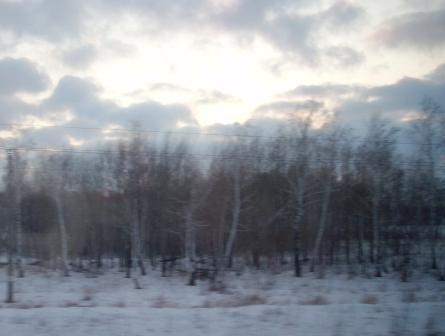 Зимний закат из окна поезда