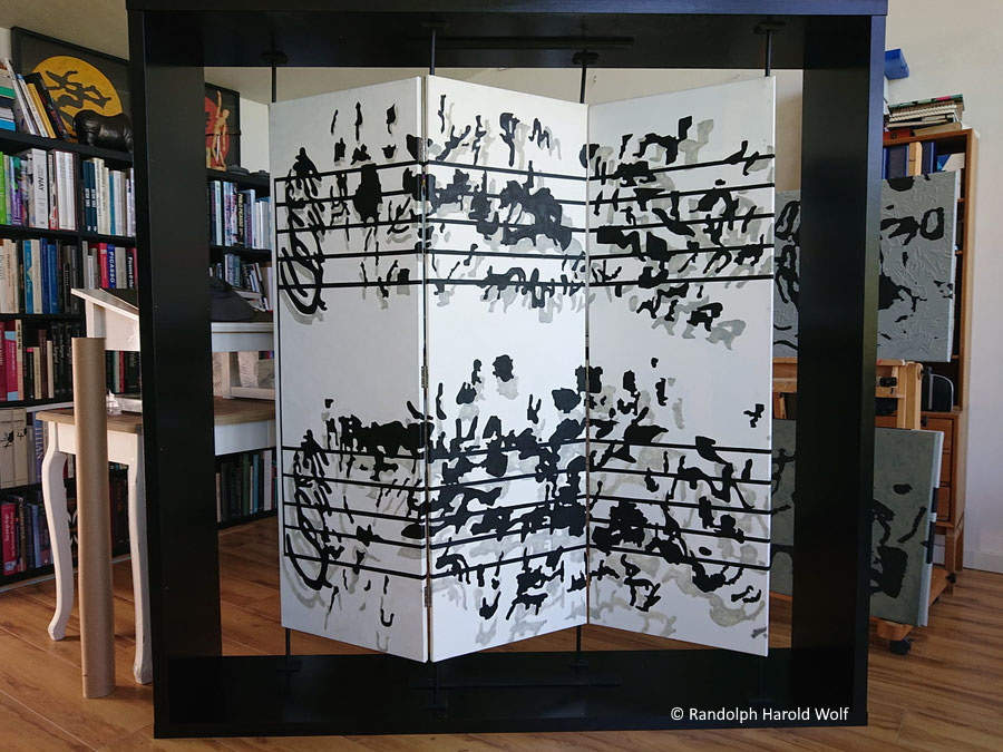 """Installation with """"Dancers and Music"""" in black and white on canvas 150 xm x 150 cm made up of three hinged panels and mounted floating in a 183 cm  x 183 cm wooden frame."""