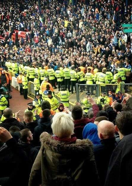 Anxious Burnley fans look on in silence before goading Rovers fans with songs about the late Jack Walker. 17/03/2013.