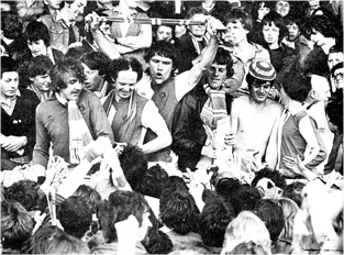 10,000 Rovers fans and players celebrate promotion at Bury, Bury fans were placed in the away end and Rovers fans had the rest of the ground. 1980.