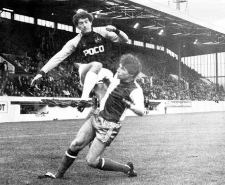 Derek Fazackerley goes in against Burnley's Martin Dobson at Turf Moor, 27/12/1982, 1982-1983 season. Rovers won 0-1 and completed the double over Burnley at Ewood Park.