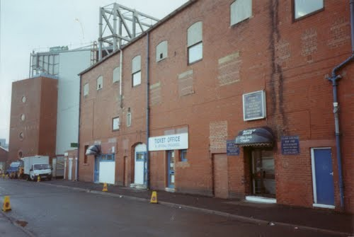 Old meets new: The old Nuttall Street Stand designed by the legendary Archie Liech meets the new Blackburn End, 1994.