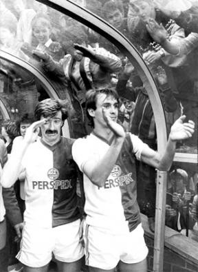 Jimmy Quinn applauds the Rovers fans with Ian Miller behind him in tears as Rovers come back on to the pitch to thank the fans after narrowly missing out on automatic promotion by 1 point, final game of the season at Ewood Park, 11/05/1985.