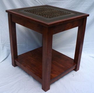 end table with vintage cast iron floor vent grate