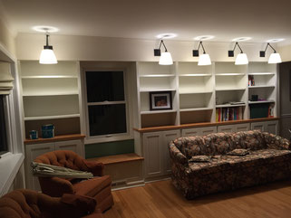 wall-to-wall shelves, cabinets, window seat and lights