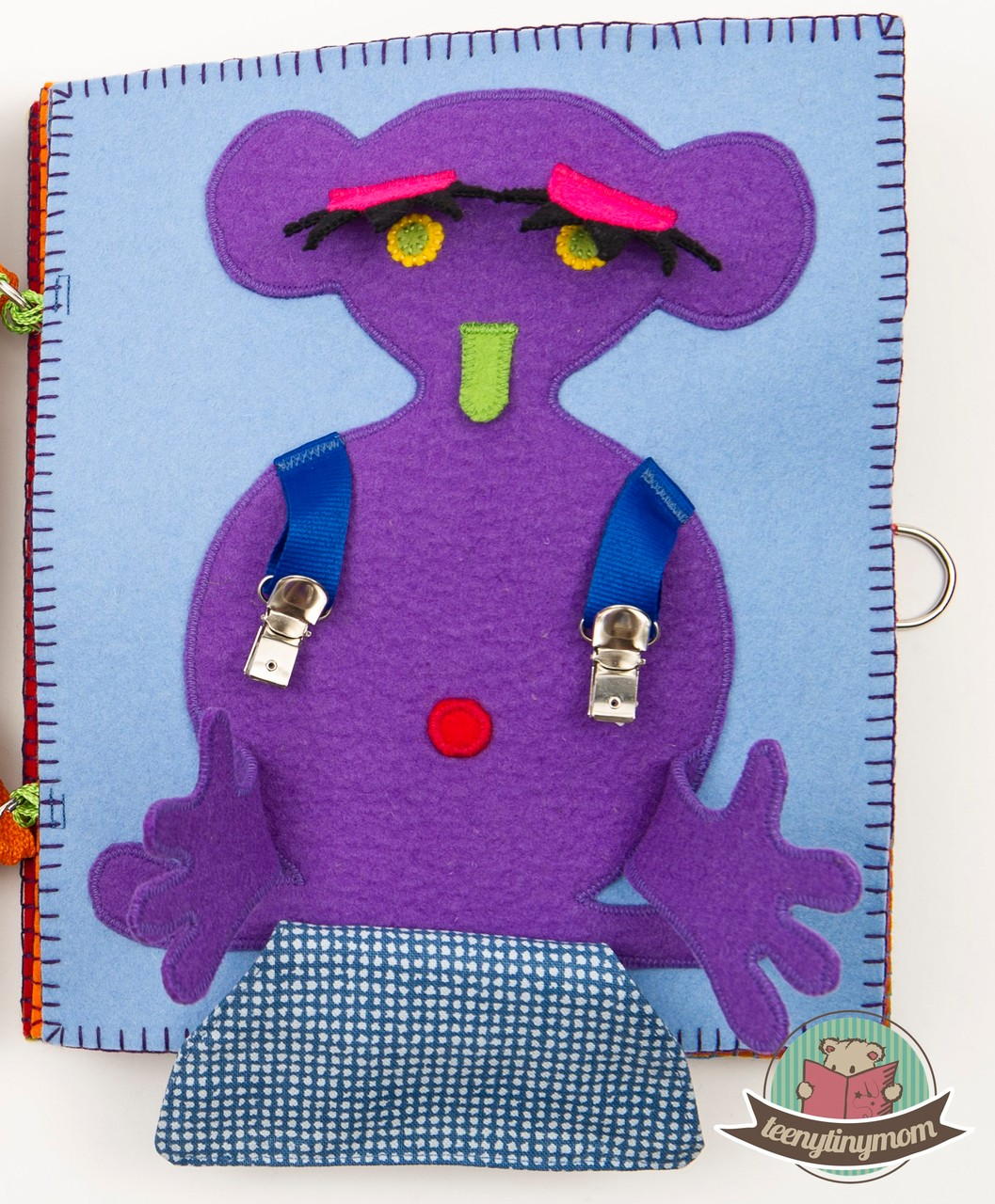 The suspender monster has a belly button hidden underneath its pants.