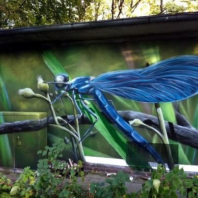 Graffiti auf der Wand für Stromanbieter Vattenfall gestaltet durch Appolloart ein Stromhaus mit Graffiti im Fotoreaslismus