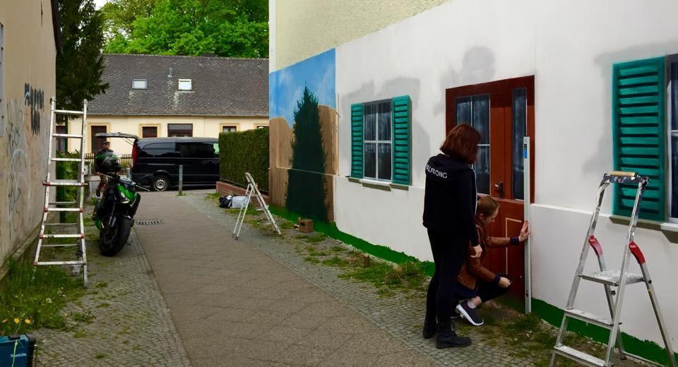 Wandbilder an der Fassadenwand outdoor im Aussenbereich airbrush Graffitikünstler