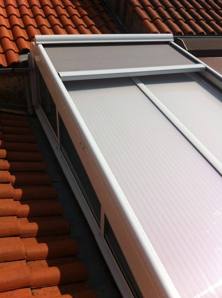 remplacement des plaques de polycarbonate et pose d'un store de protection à la chaleur