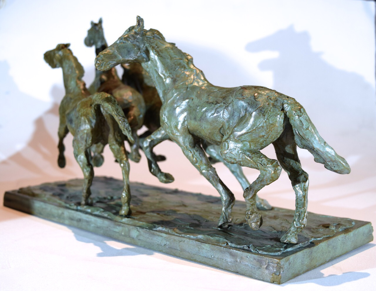 """""""Quatre Chevaux en Fuite (Four Horses Fleeing, Trigger, Sid, Java, Joey)"""", bronze, 42cm x 18cm x 24 cm. Jess Wallace"""