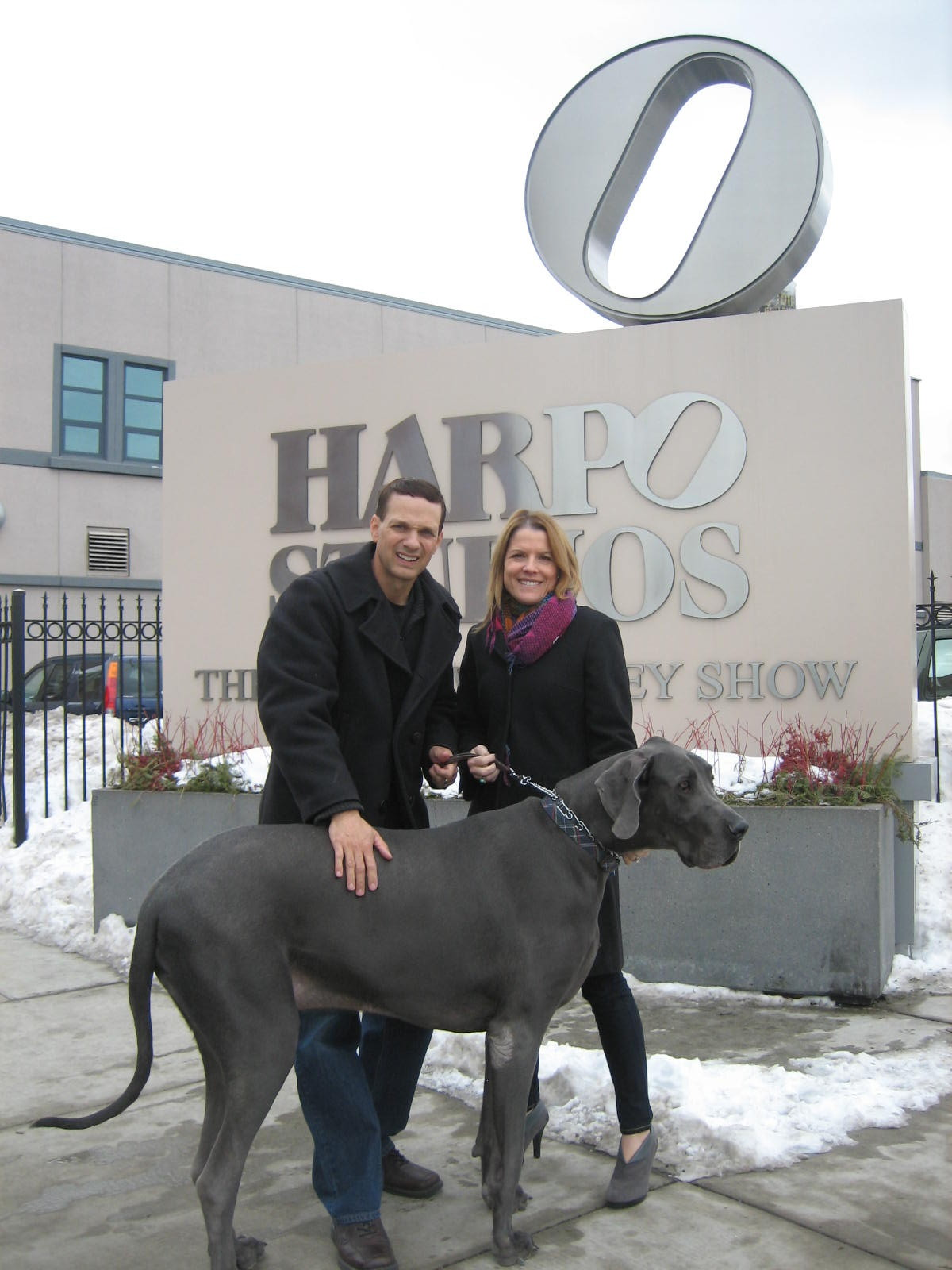 George standing out in front of the Harpo/Oprah Studios after the interview.