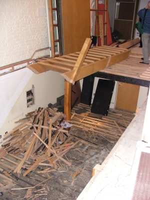 The rehearsal room, stairs taken out, floor ripped up.  Note the burnt beam (right hand side), a legacy of the infamous Workhouse fire.