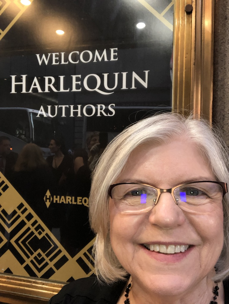 author Diane Gaston reading a book