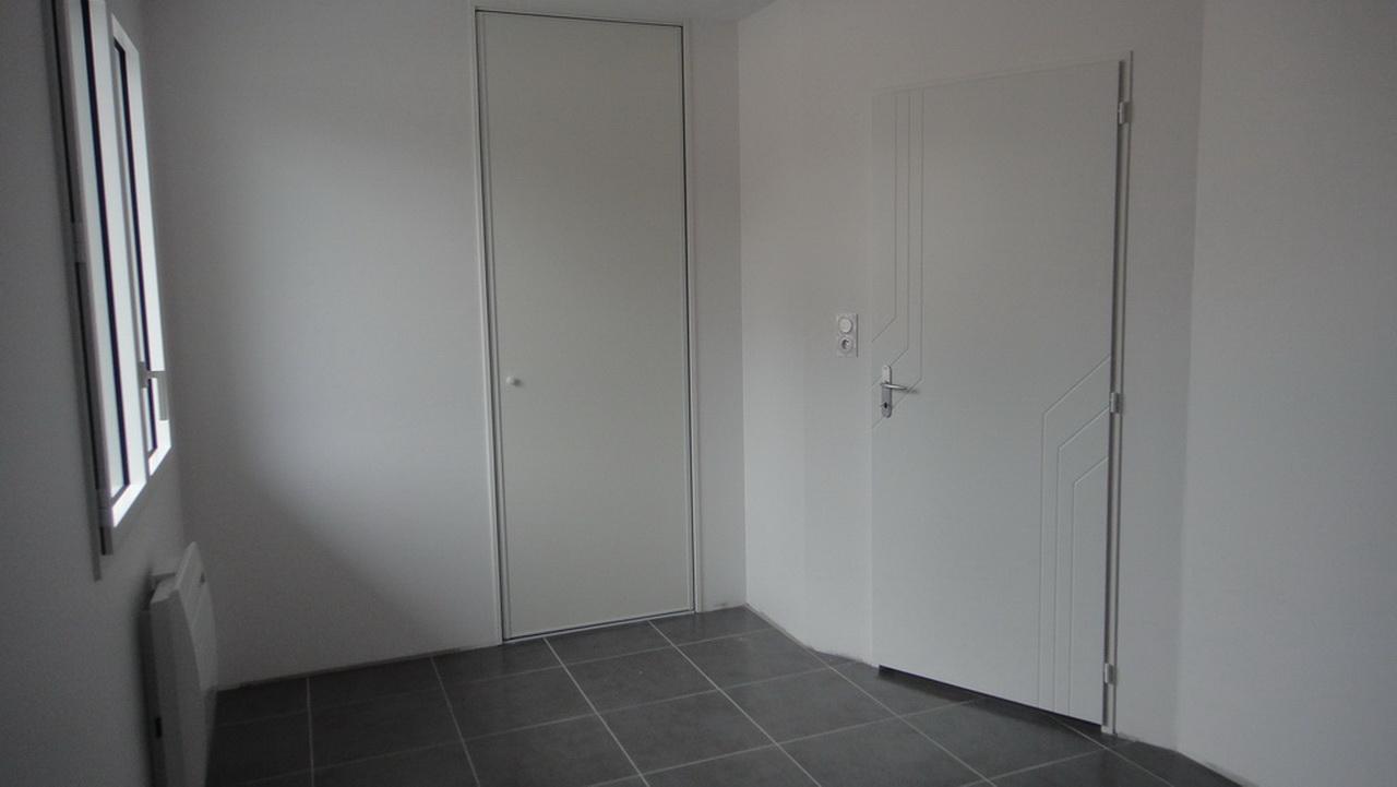 Une chambre d'un appartement 3 pièces