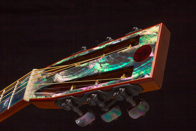 Abalone shell sheet on the headstock and fretboard