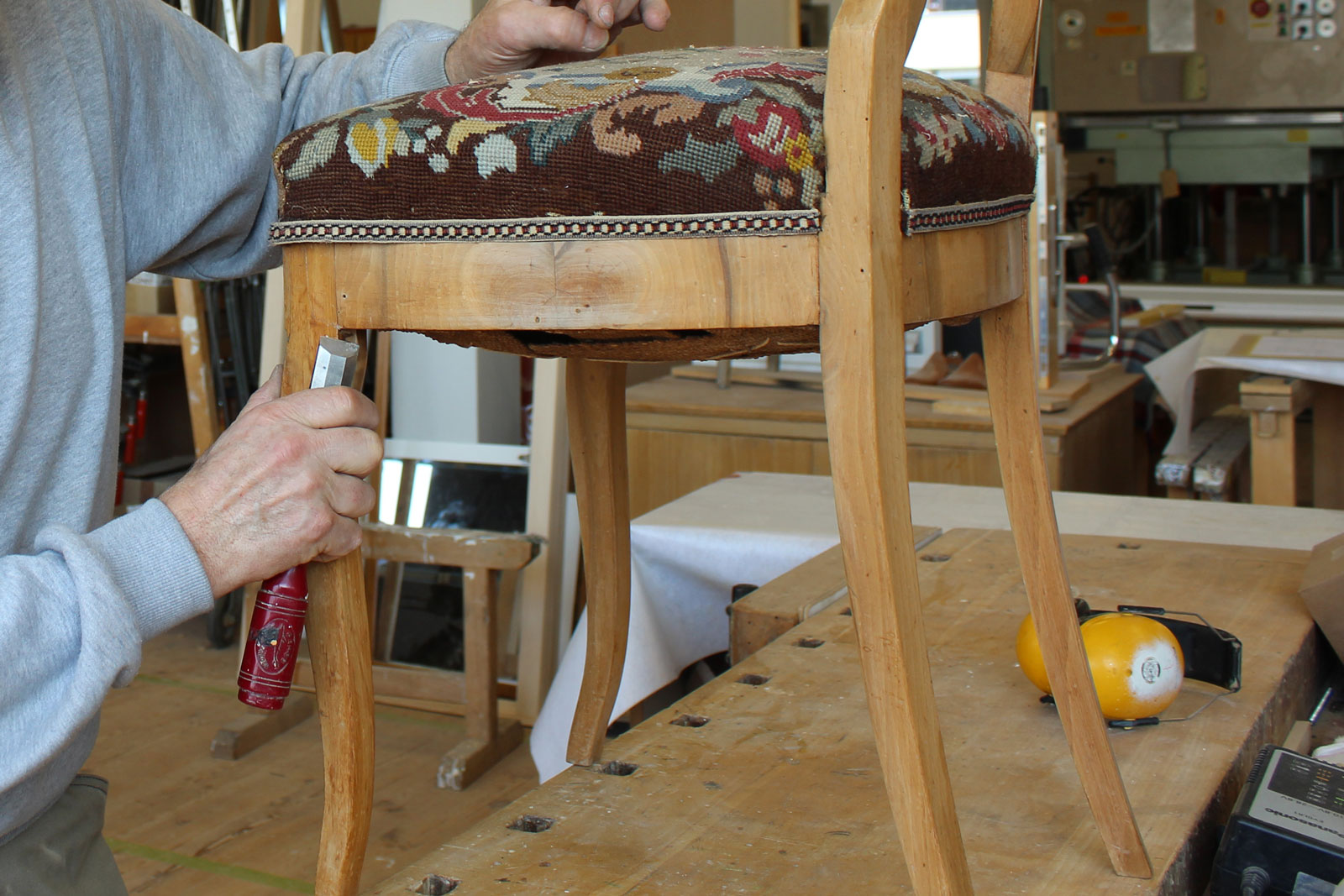 Once the wood is repaired, the upholstery can be reattached.