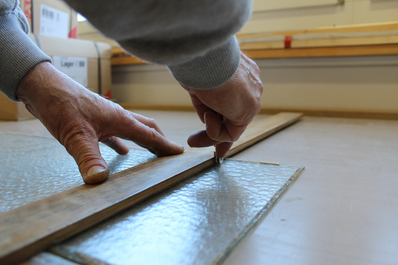 Cutting special glass to size for a window repair.