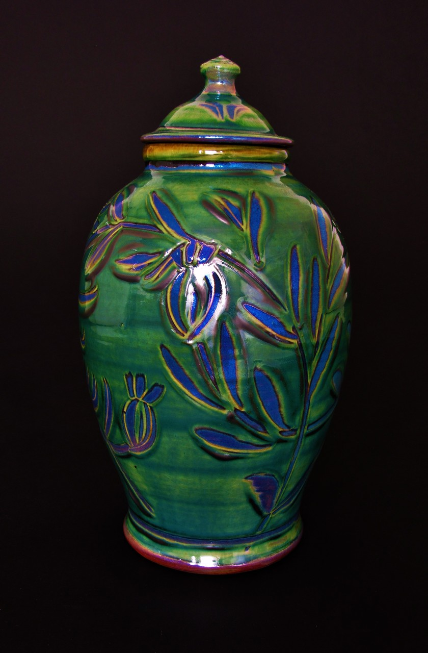 Tall, thrown lidded jar(ht: 37cm). Copper green, Beautiful purple blue lustre. £95