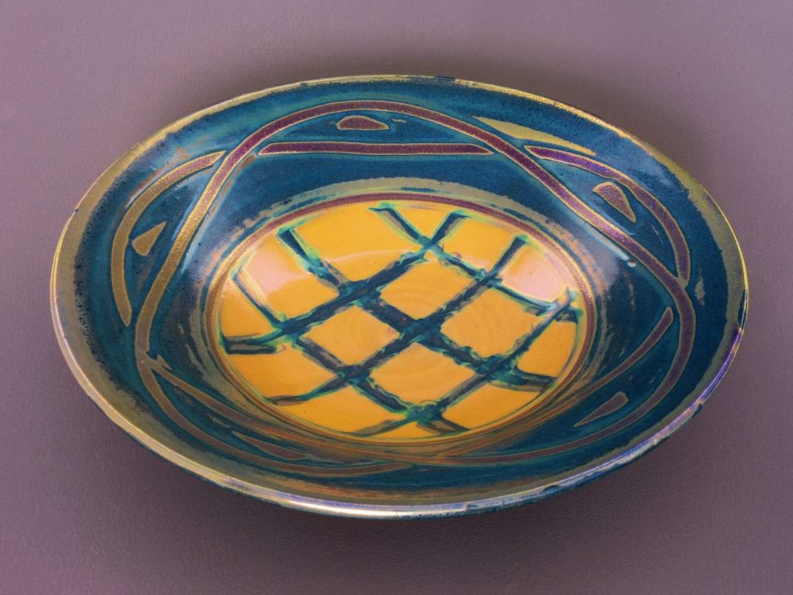 Large 14'' dish. Slipware-lustre. £95 Available from Rum's Eg Gallery