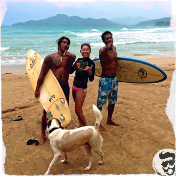 Wave Surfing in El Nido. Duli Beach. Surfboard. Happy people. Dog.