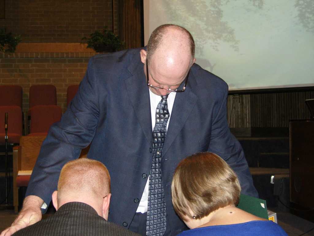 Prayer with Bro. Osborne during the ordination service in November