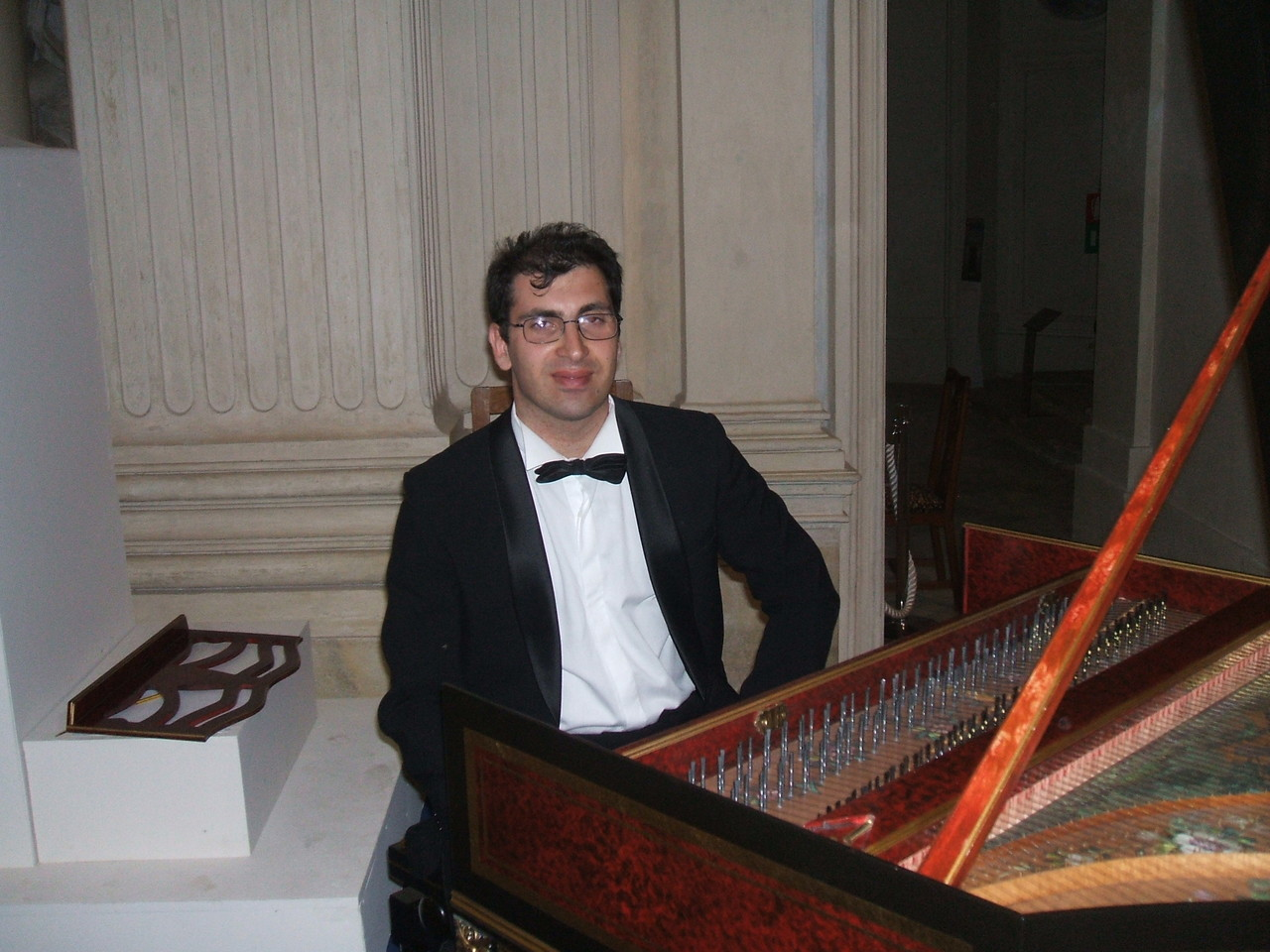 ..at the harpsichord