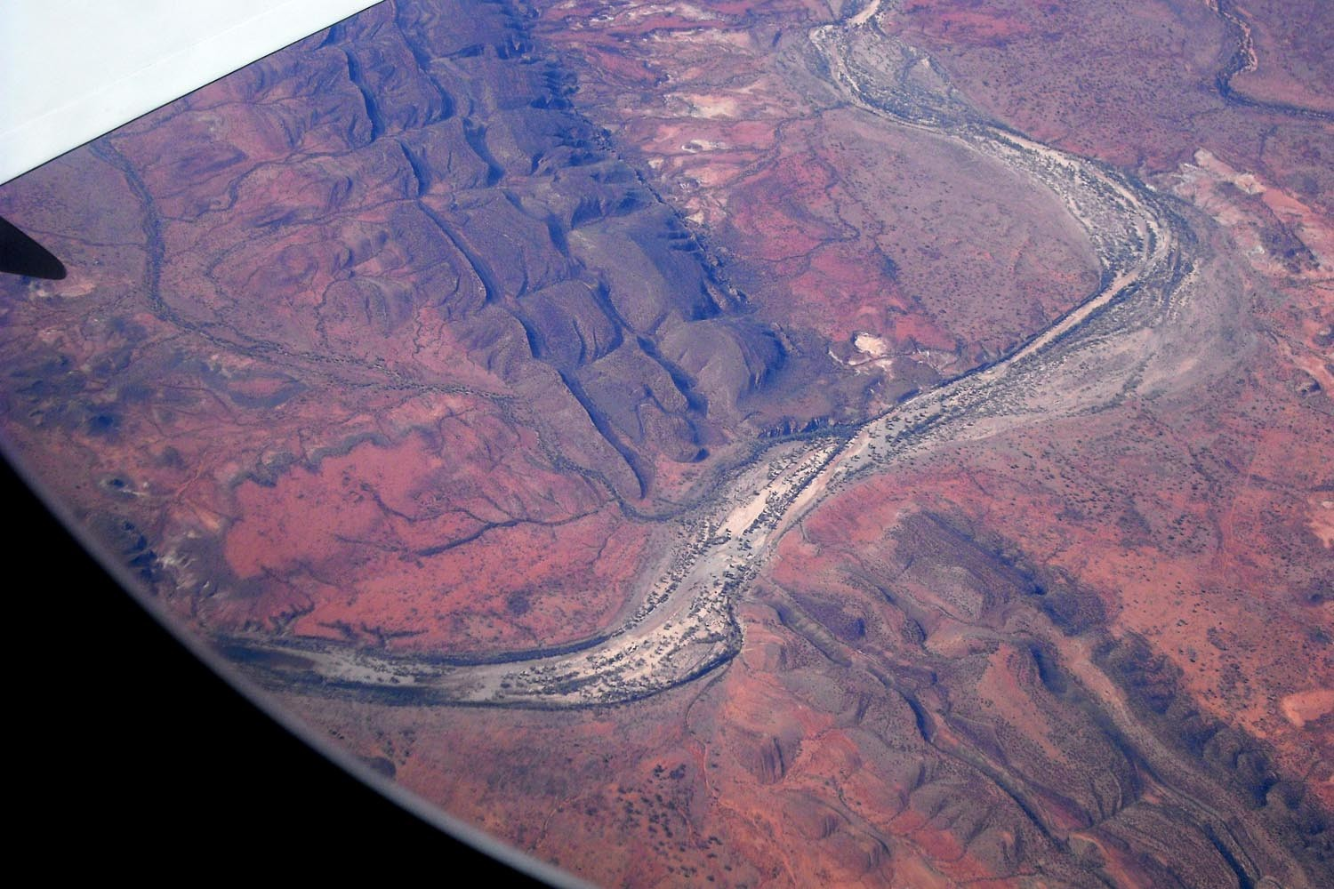 A river bed cutting through an ancient mountain range in Central Australia