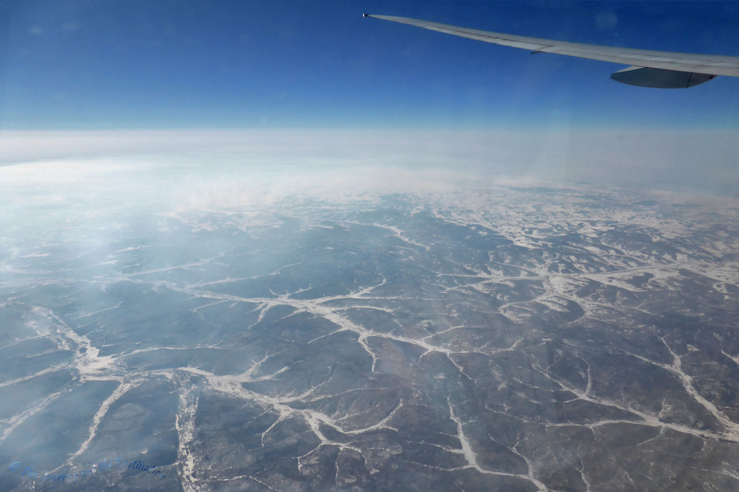 Snow and ice filled valleys in mountains in either China or Mongolia