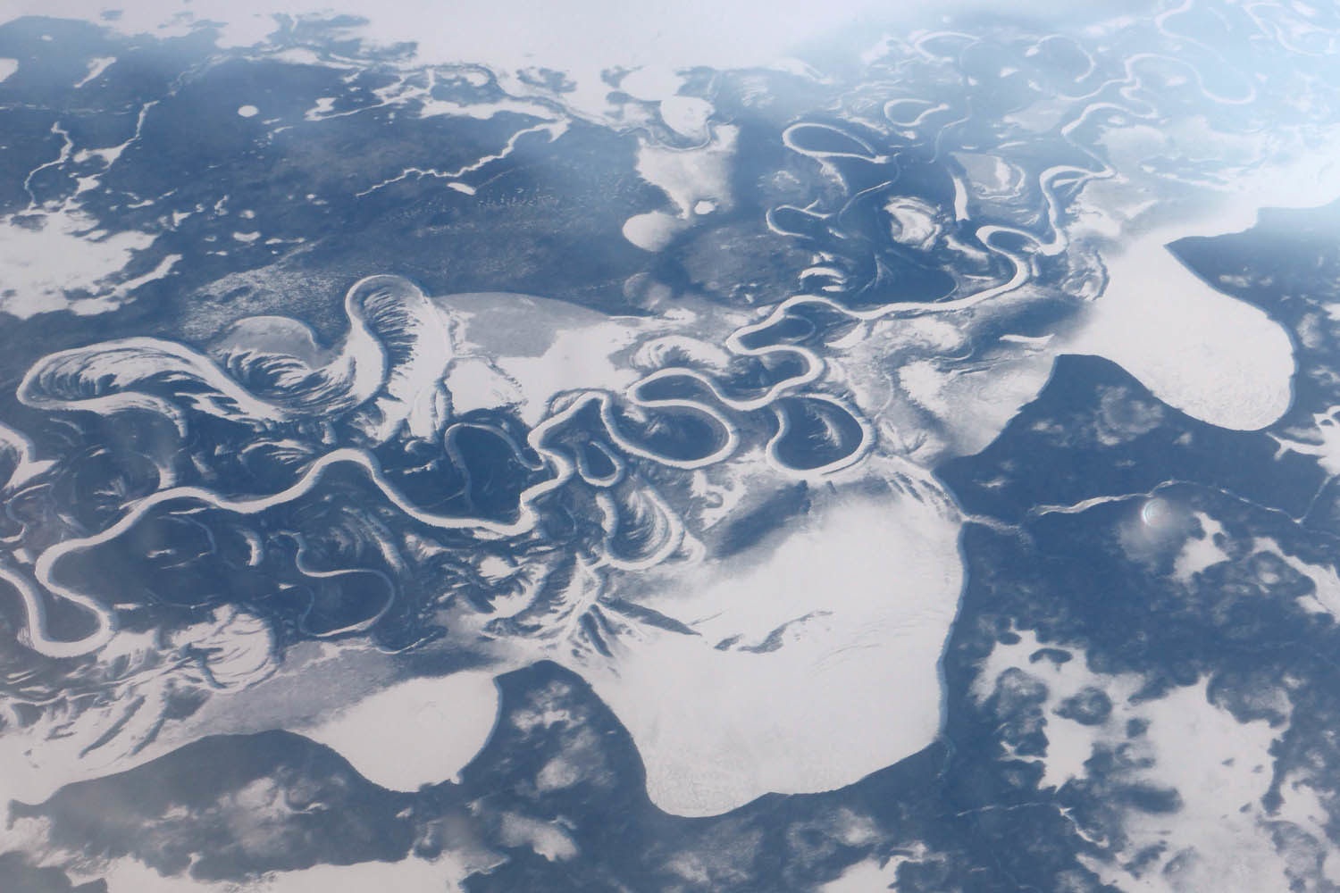 Frozen rivers meandering through forest