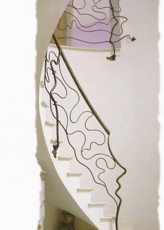 Escalier   tout en arrondi rampe moderne