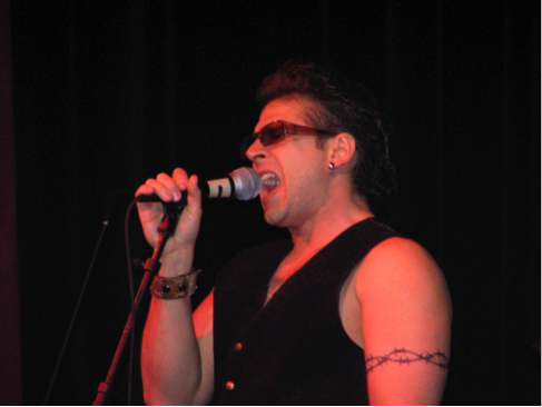 Me as lead singer for music education faculty rock band Rubric. The earrings are clip-ons and the tattoo is temporary.