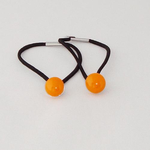 A1446. Haarelastiek. oranje opaal glas. maat steentje ca. 11 mm.  per stuk €1.75,  per 2 €2.75.