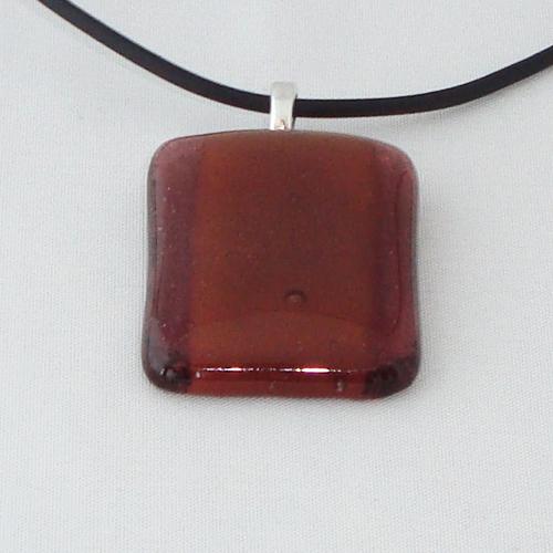 H3258. Helder bruin en amber opaal glas. afm. ca. 3.5x2.5 cm.     €9.50.
