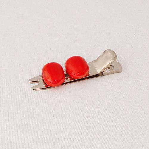 A1472. Haarclip kort. rood gemarmerd opaal glas. maat steentje ca. 10x15 mm. €3.75.