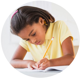Girl concentrating and writing in a notebook