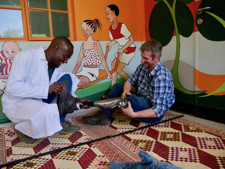 Chatting with one of the prosthetists at CoRSU Hospital in Uganda.